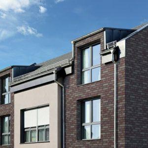 Klinkerfassade mit Handform Riemchen purpur und Winkelriemchen grau purpur Asteroidenhaus